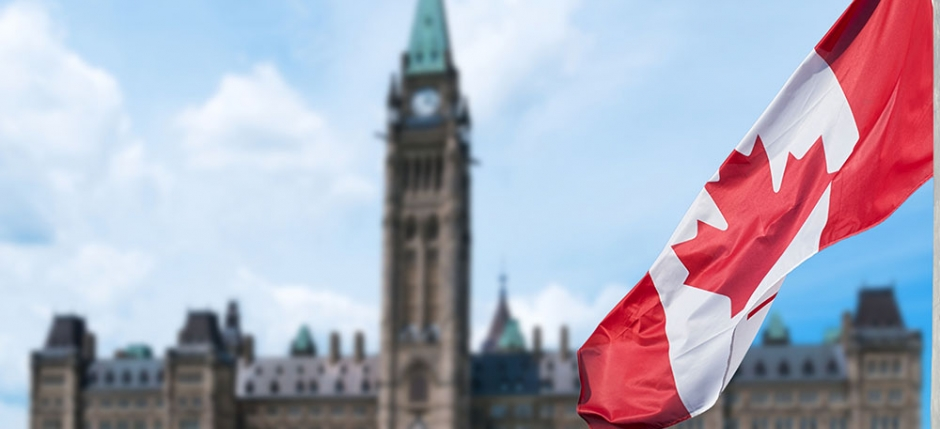 Canadian parliament building with Canadian flag