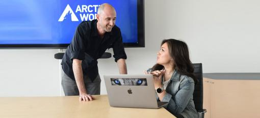 Colleagues collaborating in an Arctic Wolf boardroom